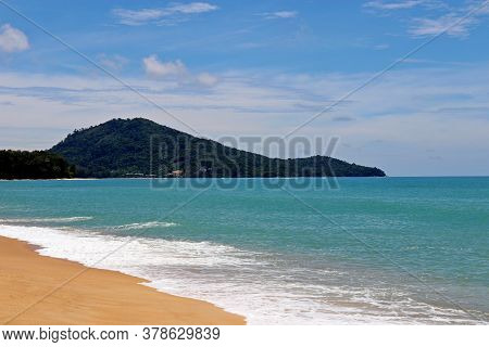Tropical Sandy Beach, Scenic View To Empty Sea Coast With Yellow Sand, Azure Water And Green Island.
