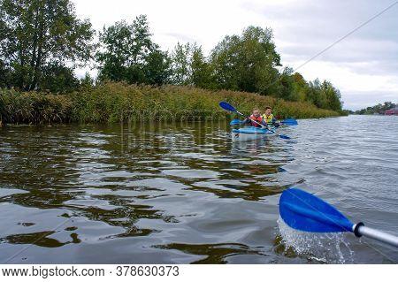 Young People Rafting On The River, Kayaking On A Calm River, Matrosovka River, Slavsky District, Kal