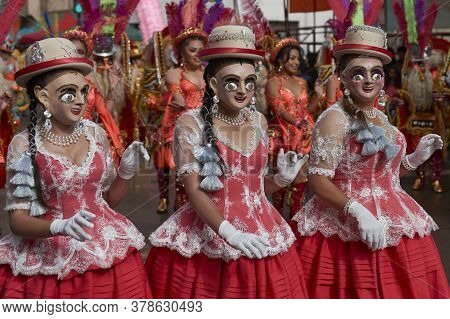 Oruro, Bolivia - February 25, 2017: Diablada Dancers In Ornate Costumes Parade Through The Mining Ci