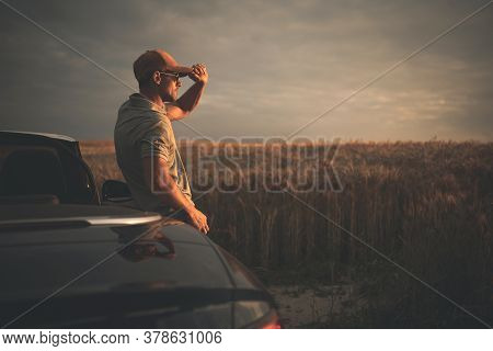 Forty Years Old Caucasian Men Enjoying Summer Season Countryside Sunset While On Drive For A Pleasur