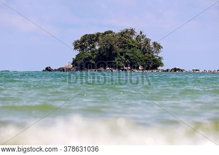 Tropical Island With Coconut Palm Trees In A Ocean, Picturesque View From The Water, Selective Focus