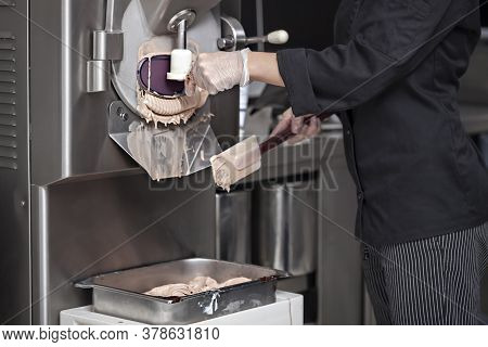 Getting Nugat Ice Cream From The Ice Cream Maker Machine In The Small Manufacturing - Using A Stainl