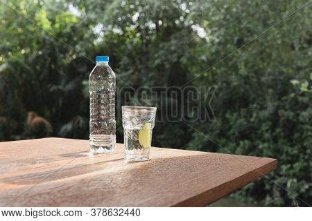 Refreshing Drink Glass Of Water With Slice Of Lime On Wooden Table.