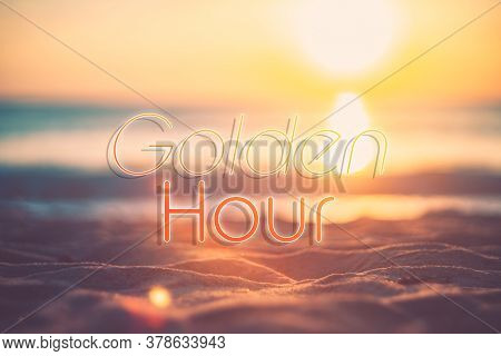 Golden Hour Words On Blur Tropical Sand Beach With Bokeh Sunlight Wave Abstract Background. Copy Spa