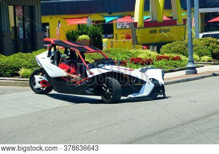 Virginia Beach, U.s.a - June 30, 2020 - A Three-wheeled Polaris Slingshot Motor Vehicle On The Stree