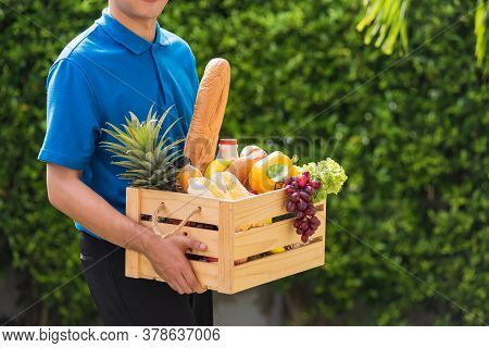 Asian Man Farmer Wears Delivery Uniform He Holding Full Fresh Vegetables And Fruits In Crate Wood Bo