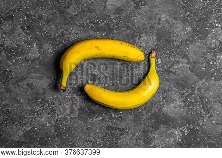 Bananas With Defects On Gray Dark Background