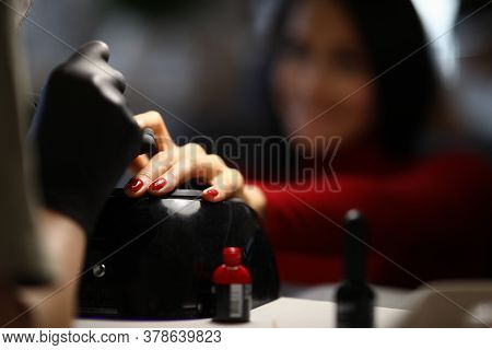 Happy Woman In The Salon Does A Manicure. Beautiful Nails With A Smooth Coating And Impeccable Shape