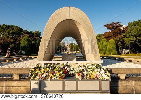 Hiroshima, Japan, 31/10/2019. The Hiroshima Victims Memorial Cenotaph With View Of Atomic Bomb Dome
