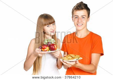 Smiling Teenegers Shows A Healthy  Lunch Isolated Over White