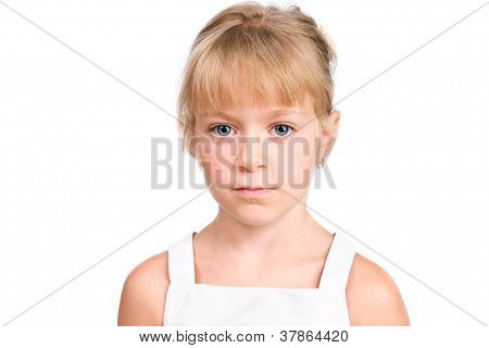 Sad Little Girl Looking At Camera With Serious Face Isolated Over White