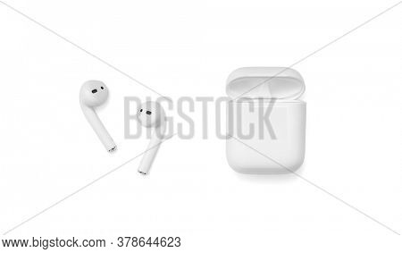 Belgrade, Serbia - July 2020. Apple AirPods 2 on a white background. Wireless headphones and charging case, including clipping path