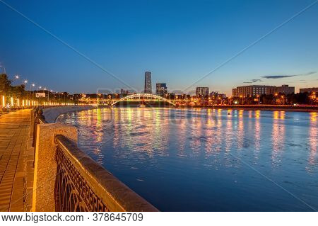 View Of The Railway Bridge Over The Evening Moscow River. Reflection Of Night Lights In The Waters O
