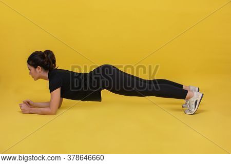 Smile Happy Beautiful Portrait Young Asian Woman Stretching Exercise And Plank Workout On Yellow Bac