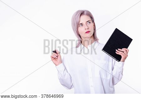Portrait Of Young Business Woman With Notepad, Standing, Holding Textbook Organizer In Hand And Pen,