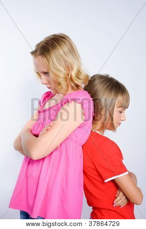 Two Girls In Conflict Standing Back To Back