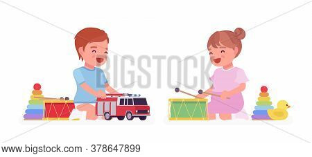 Toddler Child, Little Boy And Girl Enjoy Playing With Toys. Cute Sweet Happy Healthy Baby Aged 12 To