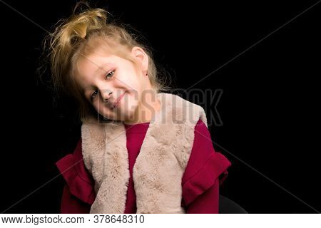 Close Up View Of Cute Smiling Blonde Girl Looking At Camera, Adorable Child Wearing Stylish Clothes
