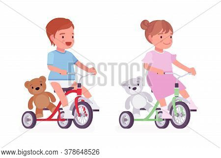 Toddler Child, Little Boy And Girl Riding A Tricycle With Teddy Bear. Cute Sweet Happy Healthy Baby,