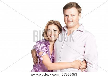 Portrait Of Happy Young Woman Embracing Her Husband - Isolated Over White