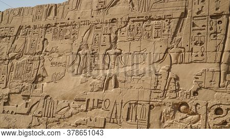 Luxor Egypt Karnak Temple Behind Big Wall Craved With Hieroglyphics Of God And Pharaoh Large Size