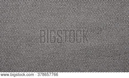 Grey Denim Background.the Texture Of Denim Grey Fabric Is Fluted In Light Stripes.