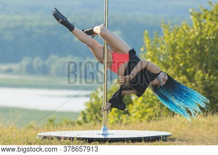 Sexy Woman With Blue Braids On High Heels Dancing By The Pole On Nature - Spinning On The Pole
