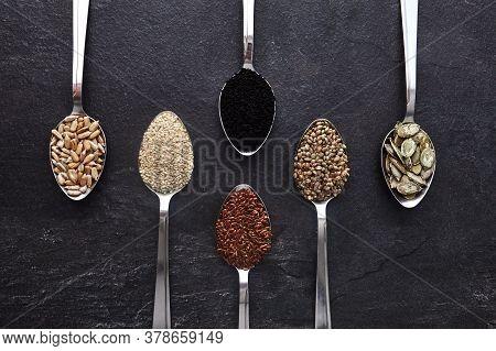 Various Seeds Assortment On Dark Background. Set Of Seed: Sesame, Sunflower, Pumpkin, Flax, Hemp, Bl