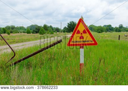 Warning Sign Radioactivity At Entrance To Resettled Village Of Pogonnoye In Chernobyl Exclusion Zone