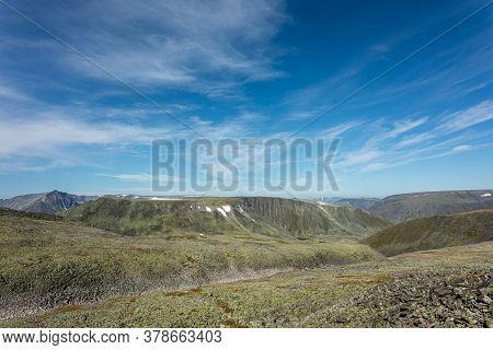 The Concept Of Outdoor Activities In The Mountains. Minimalist Mountain Landscape. Atmospheric View.