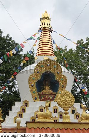 DOKKUM, NETHERLANDS, 23 JULY 2020: Traditional golden stupa of a tibetan buddhist temple. Karma Deleg Cho phel ling is a buddist meditation centre in Hantum near Dokkum, Friesland.