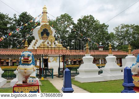 DOKKUM, NETHERLANDS, 23 JULY 2020: Traditional golden stupa of a tibetan buddhist temple. Karma Deleg Cho phil ling is a buddhist meditation centre near Hantum in Friesland.