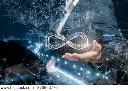 Unlimited Internet Concept. Business Woman Shows The Infinity Sign On The Background Of The City.