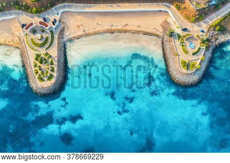 Aerial View Of Beautiful Sandy Beach, Clear Blue Sea, Promenade, Swimming People In Clear Water, Gre