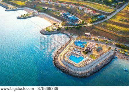 Aerial View Of Beautiful Sandy Beach, Blue Sea, Restaurants On The Promenade, Pool, Umbrellas, Clear