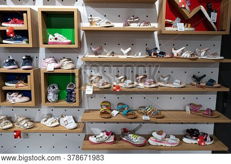 Nice, France 25.07.2020 Modern Closeup Of Different Colors Childrens Shoes On White Background For L