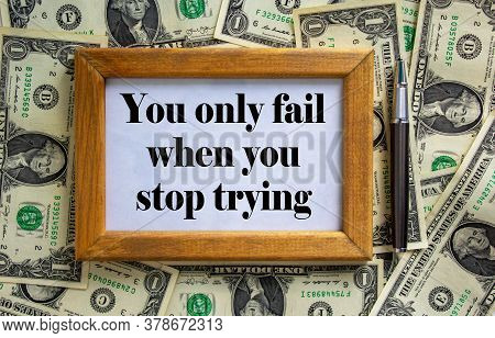 Wooden Picture Frame With Inscription 'you Only Fail When You Stop Trying' On Beautiful Background F
