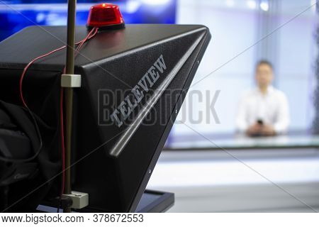A Male News Anchor In A Broadcast Studio Reads Text On A Teleprompter. Camera In The Tv Studio.