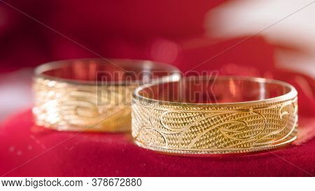 Two Wedding Rings In A Red Heart-shaped Box