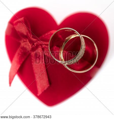 Two Wedding Rings Red Box Shape Of A Heart.