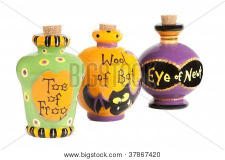 Halloween potion ingredients in ceramic containers