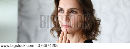 Portrait Of Businesswoman Looking Away With Calmness And Seriousness. Serious Female Person Touching