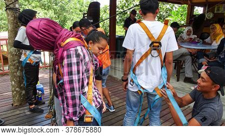 Kota Belud,sabah-sept 9,2018:a Close Up And Rear View Of People Wearing Safety Harness And Climbing