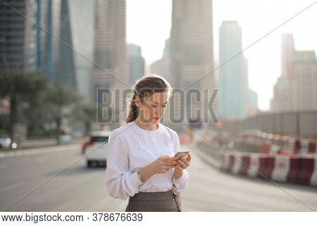 portrait of woman on the phone in dubai