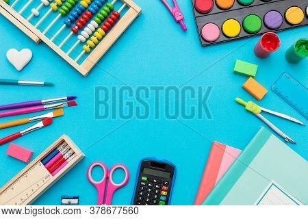 School Supplies On Blue Color Background, Top View, Copy Space