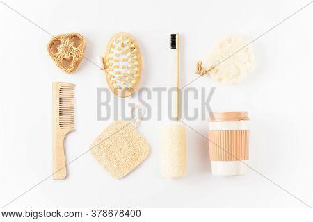 Reusable Eco Friendly Items On White Surface. Bamboo Toothbrush, Detangling Hair Brush, Coffee Mug,