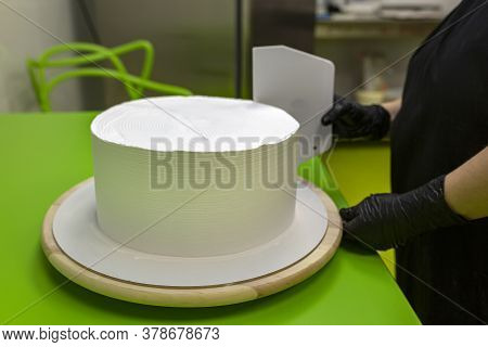 Cake Cooking. The Chef Cook Makes The Mold For The Preparation Of A White Round Cake. Daub With Whit
