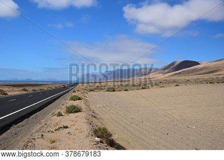 Tar Highway Through The Volcanic Landscape. Lanzarote. Canary Islands. Spain