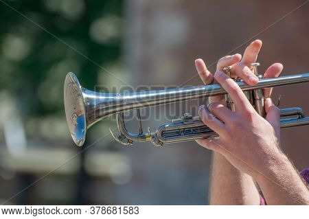 Hands Of The Musician Playing A Trumpet. Close Up Musician With Trombone On A Public Event.