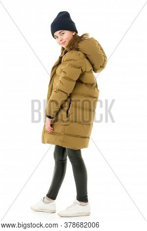 The Concept Of Fashionable Clothes For Children. Beautiful Little Girl In A Stylish Coat. Layout For